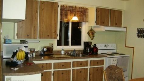Une cuisine et salon à aire ouverte pour madame Dufour ...